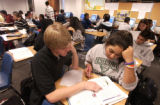 (LT. TO RT.) Colorado University at Boulder student Scott Dygulski, helps Boulder High School...