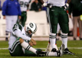 Vinny Testaverde grimaces after being hit and knocked out of the game in the 4th quarter of the...