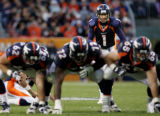 Denver Broncos kicker Jason Elam, #1, lines up a 47-yard field goal in the fourth quarter on...