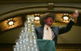 Pat Grant (cq), president of the National Western Stock Show, salutes the crowd after pouring...