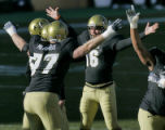 University of Colorado place kicker Mason Crosby, #16 middle, is congradulated by his teammates...