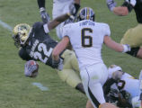 University of Colorado corner back Lorenzo Sims, left #22, dives for a first down, being chased...