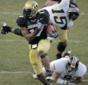 University of Colorado tail back  Lawrence Vickers, left #17, runs past Missouri defense men for...