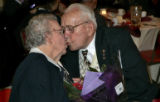 Waunita (cq) and Erlot Sloss (cq) from Arvada exchange a kiss at the annual Golden Wedding...