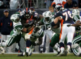 Denver Broncos Matt Lepsis, #78, left, blocks New York Jets Mark Brown #55, as Broncos runningback...
