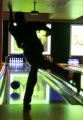 Steve Sheppard (cq) from Denver enjoys a game at Lucky Strike Lanes during his lunch break Tuesday...