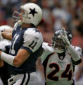 RG056 Denver Broncos' cornerback, #24, Champ Bailey, right, knocks the ball loose from Dallas...