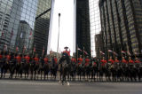 The  Royal Canadian Mounted Police stop briefly on Broadway  after parading down 17th St....