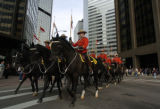The  Royal Canadian Mounted Police turn off Broadway after parading down 17th St. Thursday,...