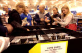 (DENVER., Colo., Nov. 26, 2005) BestBuy consumers look through a discount DVD bin as they ventured...
