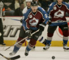 Colorado Avalanche player Milan Hejduk moves the puck down the ice against the Vancouver Canucks...