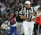 JPM0761 Oakland Raiders Warren Sapp, left, yells at referee Tony Corrente, #99, right, in the...