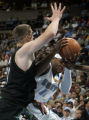 Nuggets Carmelo Anthony is fouled by Timberwolves  #35 Mark Madsen and Kevin Garnet (hand only) in...