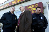 (AURORA., Colo., Nov. 28, 2005) Aurora's new police chief Daniel Oates (center) has a tour of...