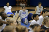 IMG Basketball Academy students Zach Zimmerman (center, cq), 15, listens to a coach speak before...
