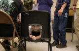 Damian Van Meer,3, (cq) plays and waits on his shot while his parents fill out paperwork. The...