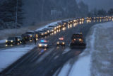 Traffic is forced off westbound I-70 at the bottom of Floyd Hill Monday evening November 14, 2005....
