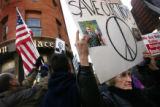 JPM536  Joyce Wells (cq) , of Denver, holds a sign with a photo of her son, a lieutenant in the...