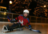Chandler Couture (cq), 7, of Littleton, skates with the puck while playing sled hockey at the...