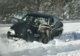 Motorists work together to try and free a car traveling east on  I-70 near mile marker 220  that...