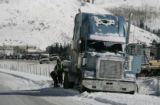 Workers try to move a semi that had jack-knifed  while traveling west on  I-70 near in Vail...