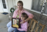 (Lt. to Rt.) Wendi Robyn (CQ) and daughter Emma DeMarco, 4, hold a portrait of son Taylor DeMarco...