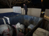 Aurora Police officer Mike Dziurgot (cq) reports a child's matress at a dumpster at the Oak Ridge...