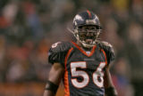 The Denver Broncos line backer Al Wilson tries to get the crowd fired up at the start of the...