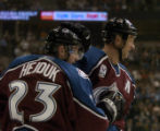 Milan Hejduk and Rob Blake celebrate Blake's first period goal against the Mighty Ducks  at the...