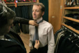 Eric Footer (cq), right, 39, gets a suit fitting by master taylor and owner David Scott, left, at...