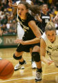 Jackie McFarland, left, fights for a loose ball with Molly Nohr, right, in the second half of the...