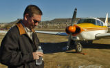Pilot Jason Sosebee (cq) stands next to the Camanche airplane that he had to make an emergency...