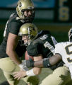 University of Colorado offensive linemen Klint O'Neal, left, looks to help out quarter back, Joel...
