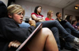 Alison Wilber (cq), 17, a senior at Monarch High School, listens as a survivor of domestic...