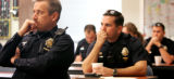 JPM004  Denver Police Department patrolman Rod Vik (cq), left, listens with other officers to Sgt....