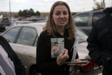 Vanessa Yaklich (cq), 31, of Pueblo, Colo., holds up a picture of her combing her fathers hair as...
