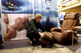 (DENVER, Colo., Nov. 17, 2005) Jean Hungerford (cq) arranges a massage chair in a seating area at...