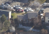 Aerial view of the Thompson home in Aurora on Friday November 18,2005. Investigators brought a ...