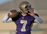 Holy Family quarterback Patrick Chappell drops back for a pass in the fourth quarter of play...