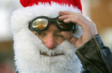 Loyd Harrell (cq), of Thornton, adjusts his goggles while wearing a Santa beard in the 20th Annual...