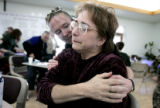 Sally Bullock, (cq) right, is hugged by  friend  Kami Smith (left, back) at a fundraiser for the...