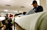 (DENVER, Colo., Dec. 05, 2005) Juan Martinez, (cq-rt)  of Grand Junction sits on his bed, Monday...