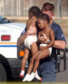 Twin 3-year-old daughters are taken into police custody after the Aurora SWAT team  was called to...
