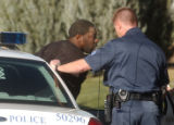Patrick Scott is put into an Aurora police car after the Aurora SWAT team  was called to the...