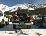 Bruce Cardin, (cq), of Denver, sits in the back of his truck having lunch on a warm day at A-Basin...