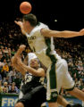 University of Colorado guard Richard Roby, bottom, is blocked by Colorado State University forward...