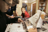 Twelve year-old Colorado Rush player Jimmy Shannon (cq, right) of Denver looks at a picture of the...