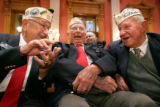 Local Peal Harbor survivors Walter Mycka, cq, 86, left, Wilmer Bailey, cq, 84, and George Richard,...