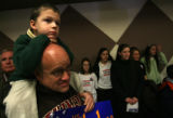 MJM785 Todd Hertzberg (cq), and his son, Jack Hertzberg, 5, watch Republican Presidential...