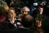 MJM1059 Janet Huckabee, left, takes a photo of her husband, Republican Presidential candidate,...
